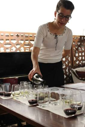 Amie pouring wine